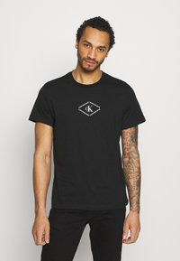 Calvin Klein Jeans - MONOTRIANGLE TEE - Print T-shirt - black - 0