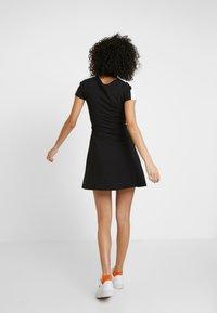 Puma - CLASSICS SHORTSLEEVE DRESS - Vestido ligero - black - 2