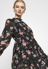 ONLY - ONLVIVIAN FLOWER FRILL DRESS - Denní šaty - black - 3