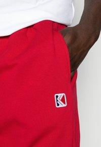 Karl Kani - RETRO TRACKPANTS - Teplákové kalhoty - red - 4