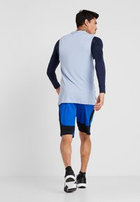 Nike Performance - DRY SHORT HYBRID - Sports shorts - game royal/black/habanero red - 2