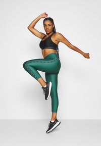 Under Armour - ANKLE CROP - Leggings - saxon green - 1