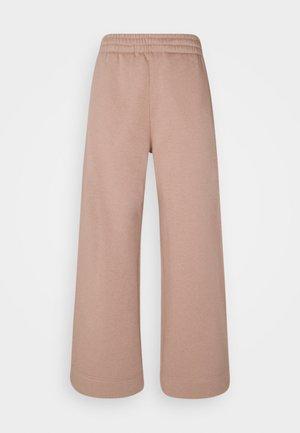 ROXA - Pantalon de survêtement - dark raspberry