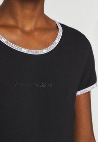 Calvin Klein Jeans - LOGO TRIM BODY - Print T-shirt - black - 5