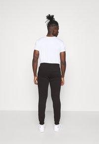 Jack & Jones - JJIGORDON  - Pantaloni sportivi - black - 0