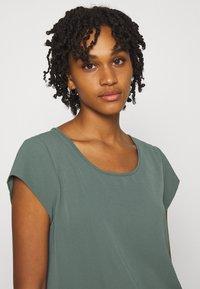 ONLY - ONLNOVA LUX SOLID - Basic T-shirt - balsam green - 3