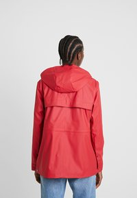 Hunter ORIGINAL - WOMENS ORIGINAL LIGHTWEIGHT RUBBERISED JACKET - Parka - military red - 2