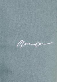 Mennace - UNISEX ESSENTIAL SIGNATURE  - Tracksuit bottoms - dark green - 6