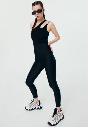 CUT - Leggings - Trousers - black