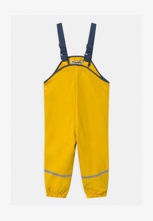 UNISEX - Pantalones impermeables - gelb