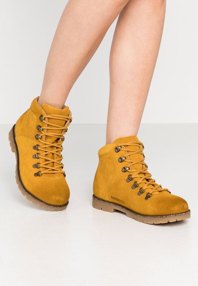 JACKSON - Lace-up ankle boots - ochre