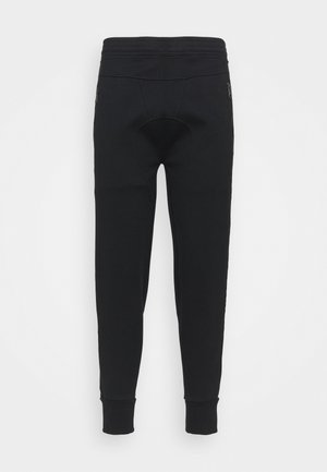 TRAVEL DOUBLE TAPE BONDED - Tracksuit bottoms - black/off white