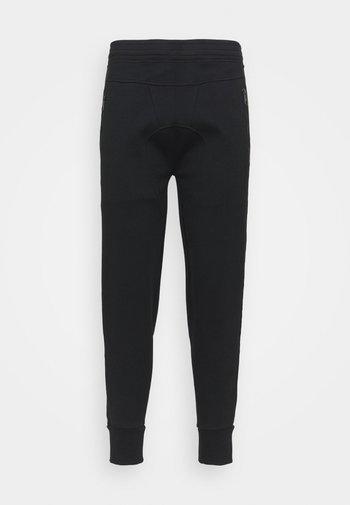 TRAVEL DOUBLE TAPE BONDED - Teplákové kalhoty - black/off white