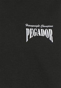 Pegador - EVANDER HOODIE UNISEX - Sweat à capuche - vintage black - 2