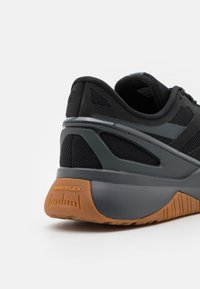 Reebok - NANOFLEX TR - Sports shoes - core black/pure grey - 5