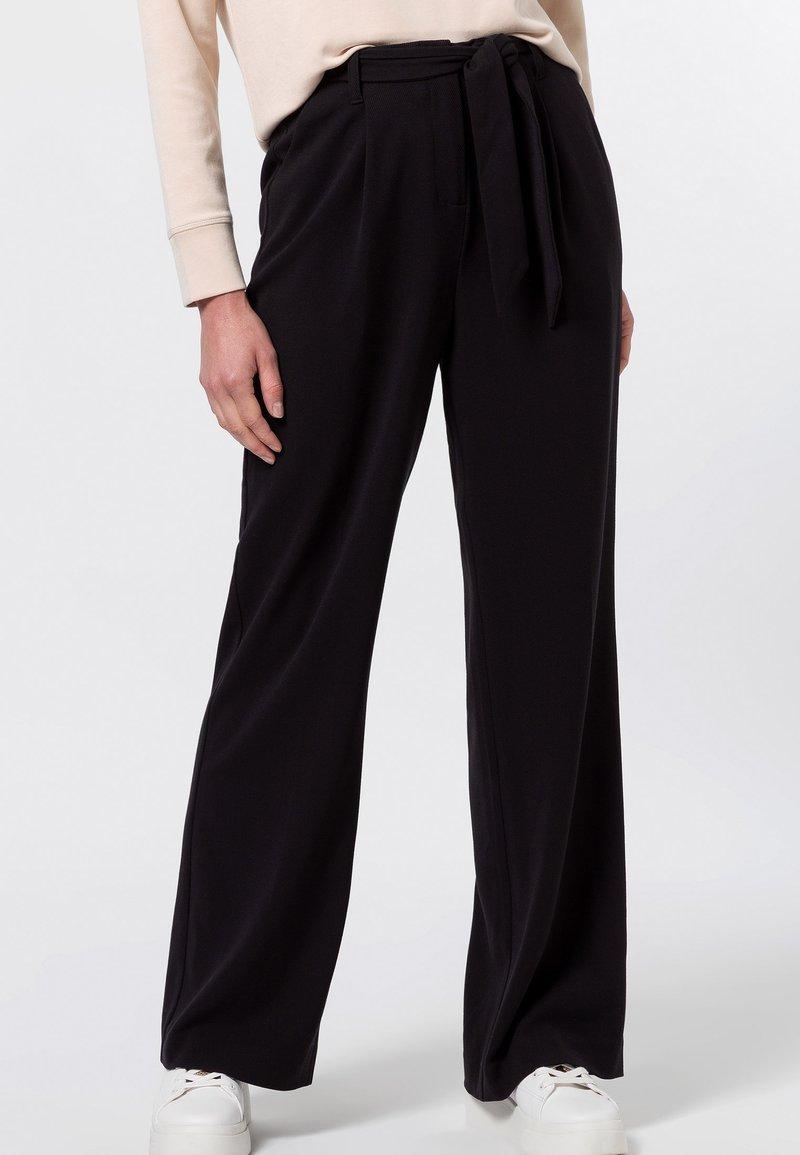 zero - Trousers - black