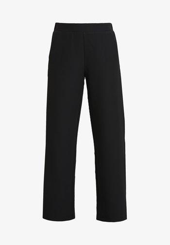 DUNA PANTS - Trousers - black