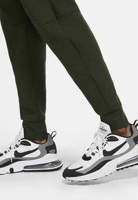 Nike Sportswear - Tracksuit bottoms - sequoia/black - 6
