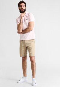 Lacoste - Polo shirt - flamingo - 1