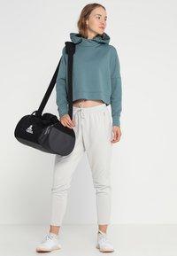 adidas Performance - Sports bag - black/grey - 1