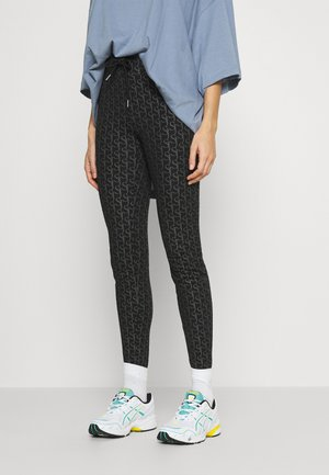 MONOGRAM - Leggings - Trousers - black