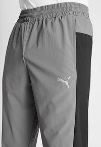 Puma - REACTIVE PACKABLE PANT - Outdoor trousers - castlerock black/white - 4