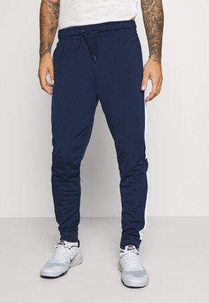 LAITO TRACK - Tracksuit bottoms - black iris/bright white