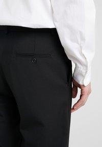 Damir Doma - PHOCAS PANTS - Trousers - black - 4