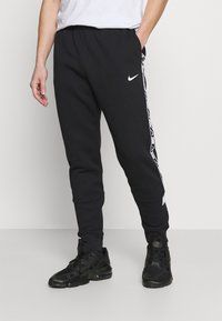 Nike Sportswear - REPEAT - Trainingsbroek - black - 0