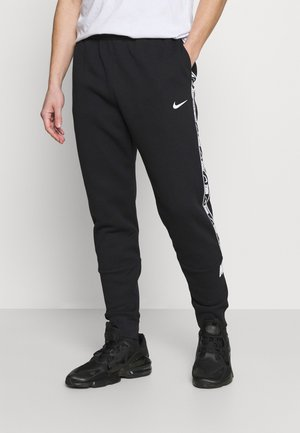 REPEAT - Pantalones deportivos - black