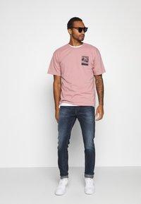 Diesel - D-LUSTER - Slim fit jeans - 009em - 1