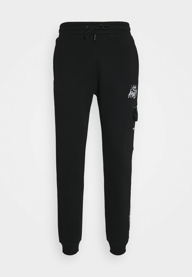 CARGO - Tracksuit bottoms - black