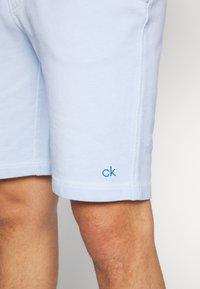 Calvin Klein - GARMENT FRONT LOGO - Teplákové kalhoty - blue - 6