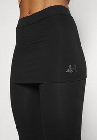 Curare Yogawear - PANTS SKIRT - Teplákové kalhoty - black - 3