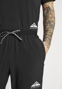 Nike Performance - ELITE PANT TRAIL - Pantalones deportivos - black/white - 4