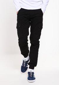 Jack & Jones - JJIPAUL JJWARNER  - Cargo trousers - black - 0