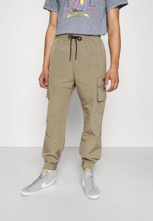 TECH TRACKSUIT BOTTOM - Cargo trousers - tan