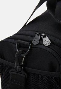 Champion - LEGACY XS DUFFEL - Sports bag - black - 4