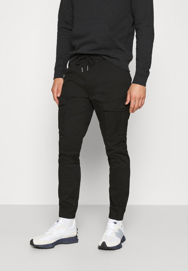 PANTS JIM CUFF - Cargo trousers - black