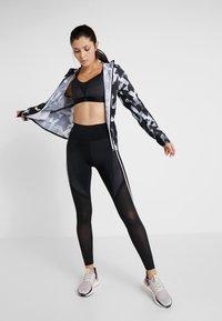 adidas Performance - TRAGEKOMFORT DESIGN BRA - Sports bra - black - 1