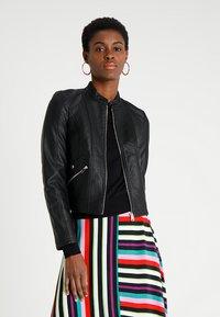 Vero Moda - VMKHLOE JACKET - Faux leather jacket - black - 0