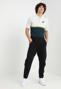 Nike Sportswear - PANT - Tracksuit bottoms - black/black - 1