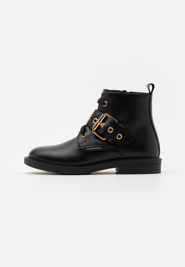 STIVALETTO - Lace-up ankle boots - black/gold