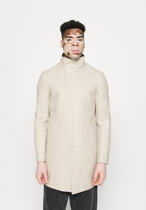 ASYMMETRIC FUNNEL NECK - Classic coat - beige