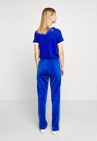 adidas Originals - FIREBIRD - Tracksuit bottoms - team royal blue - 2