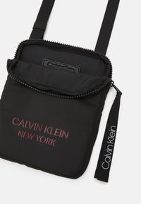 Calvin Klein - FLAT PACK UNISEX - Across body bag - black - 2