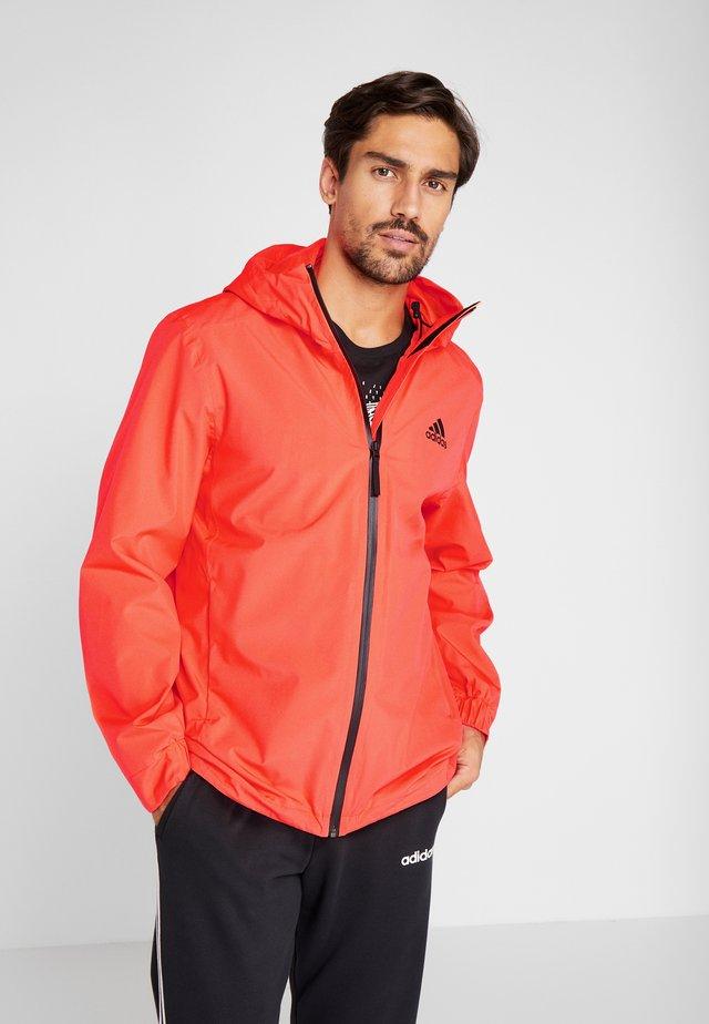 3-STRIPES RAIN.RDY - Waterproof jacket - red