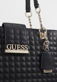 Guess - MATRIX ELITE CARRYALL - Handbag - black - 3