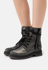 Marco Tozzi by Guido Maria Kretschmer - BOOTS - Lace-up ankle boots - black/metallic - 0