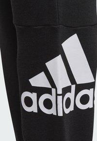 adidas Performance - ESSENTIALS FRENCH TERRY - Pantalones deportivos - black - 2
